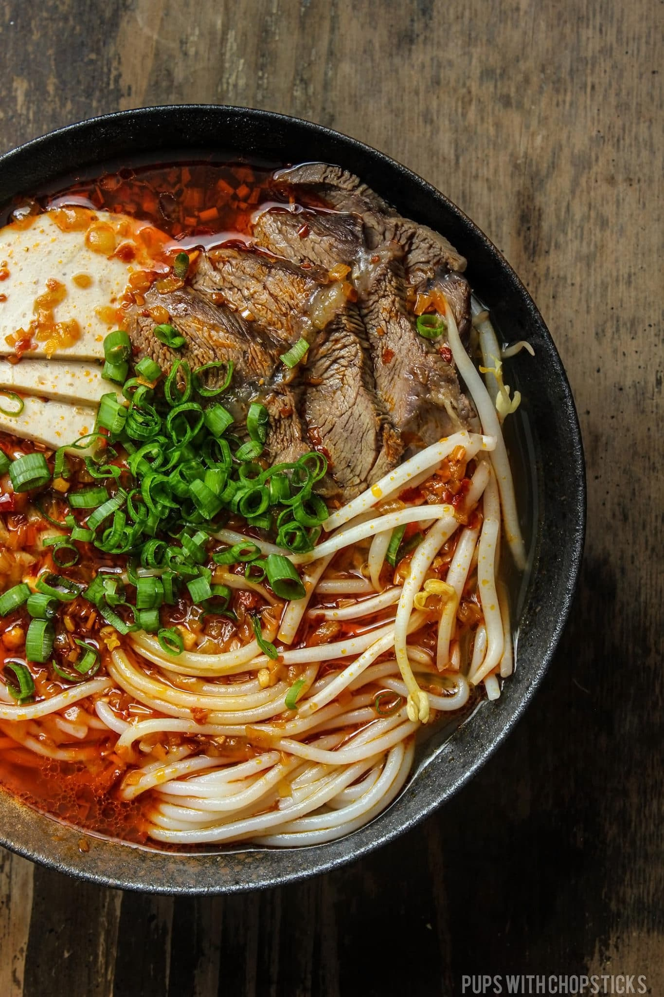 Bowl of Spicy Bun Bo Hue (Vietnamese Beef Noodle Soup)