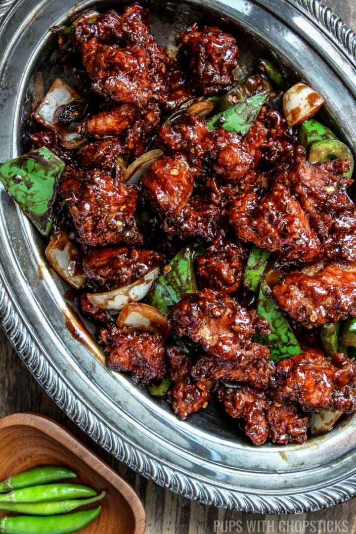 Hakka, Indian Chinese chilli chicken made with crispy chicken chunks and lightly tossed in a spicy chilli sauce.