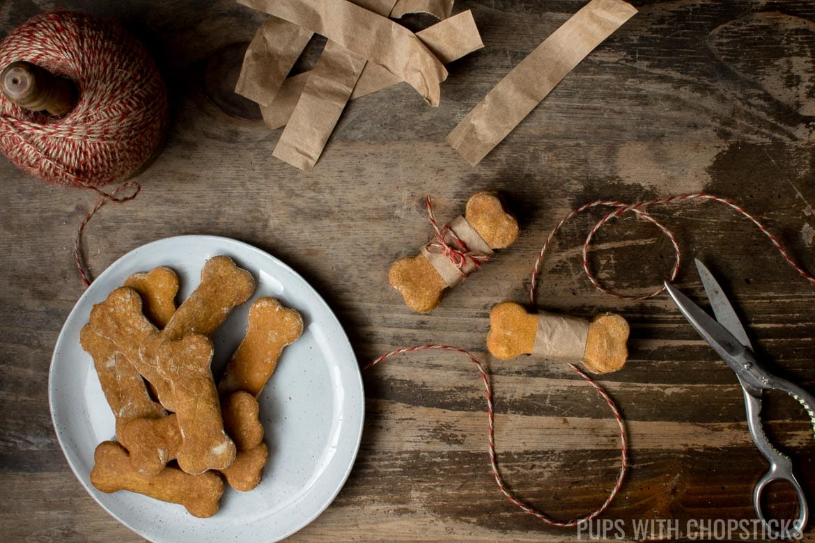 Grain free dog treats being wrapped in paper and tied up with twine