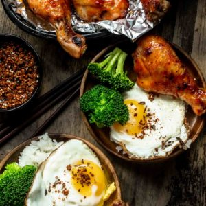 Sweet & Spicy Honey Sriracha Chicken served with rice, broccoli and a fried egg
