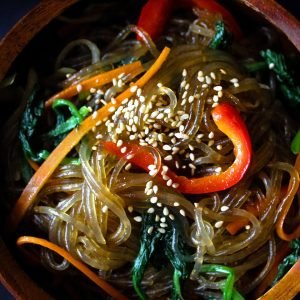 Korean glass noodle (chapchae/japchae) in a bowl on a table