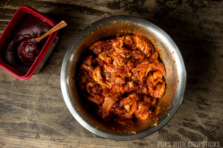 A large bowl of pork belly being marinated in gochujang, garlic, onions and ginger for Spicy Korean Pork Bulgogi (Jeyuk Bokkeum)