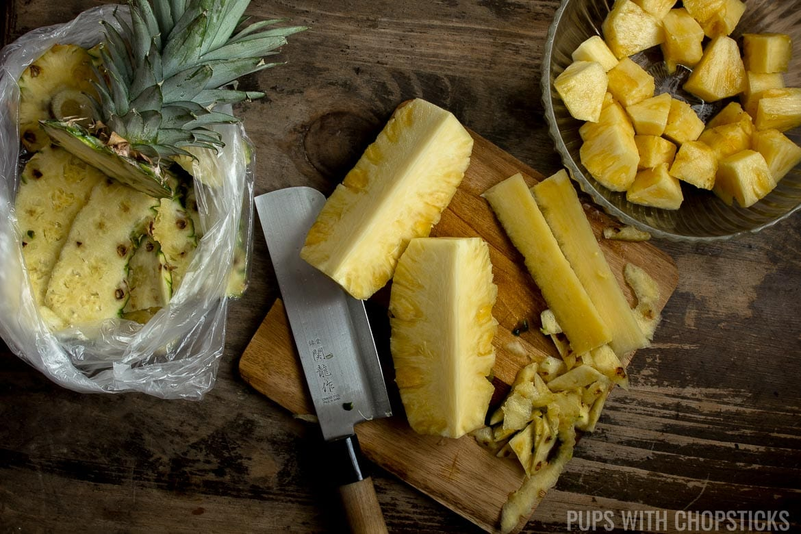 Pineapple cut up for Sweet and Sour Pork on wooden table