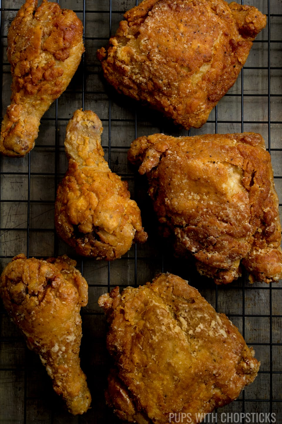 The Ultimate Super Crispy Fried Chicken Recipe that is super duper crispy, juicy and the batter never falls off the chicken so each bite is crispy to the end! #chicken #friedchicken #recipe #crispy #juicy #dinner